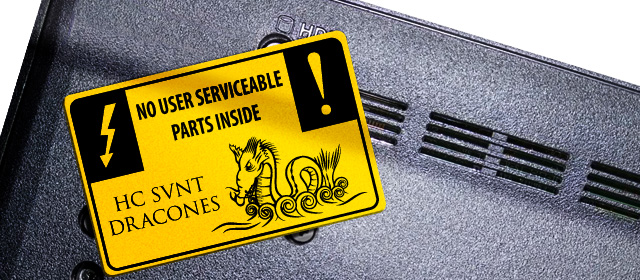 the lower case of a laptop with a sign 'no userserviceable parts! Hic sunt dracones'