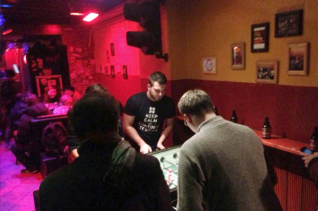 People playing table soccer after learner's meetup